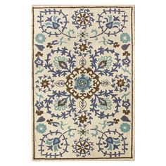 Bring a pop of style to your living room or foyer with this artfully hand-tufted wool rug, showcasing an eye-catching floral motif in blue.