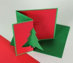 handmade Christmas card from Ashbee Design ... fancy fold with cut tree element ... red and green ... luv the bold and clean look ...
