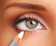 Make eyes look bigger for a photoshoot from Beauty and Fashion Tech. White eyeliner tip.