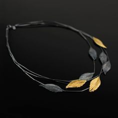 necklace from Feathers collection. Silver oxidized and goldplated