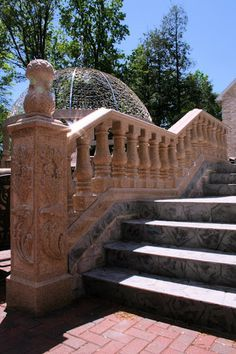 This stone staircase features an intricately carved railing. Click on the picture to take a closer look. #Stair #Railing #Staircase #Design #Stone #Natural