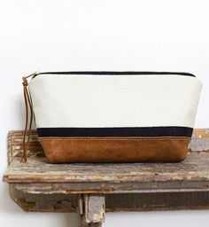 Leather zip clutch black and white color block stripes