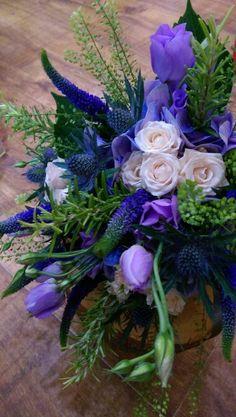 A close up of a beautiful blue tone bridal bouquet.