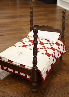 doll bed w/ red & white quilt