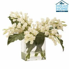 Orchids make a sophisticated style statement any time of year. In the language of flowers, they say beauty and refinement. The short, rectangular, glass water garden vase showcases the cut stems. We love this bouquet on an end or night table. Or for an unconventional and dramatic touch, group several in the center of a dining table.