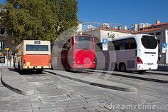 Three generation of buses parked at local bus station. From oldest and smallest to newest and largest. Concrete bus station in center of Rijeka, Croatia.