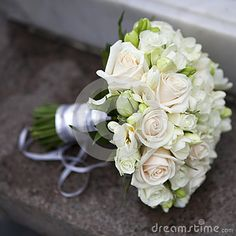 Wedding bouquet of pink and white roses and blue fresia