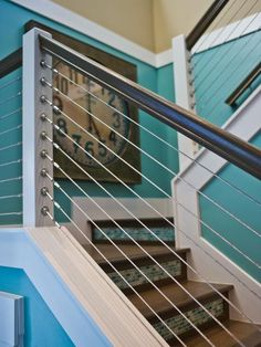 A powder-coated aluminum stair rail system visually expands the home's usable space. A decorative clock, displayed in the landing, is permanently set at five o'clock, quitting — and relaxation — time.