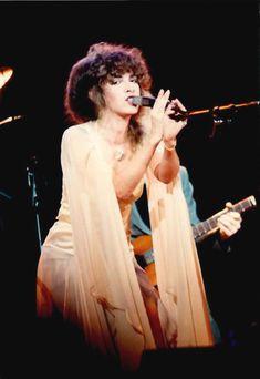 Stevie Nicks 1979, with the Rhiannon dripping chiffon sleeves, and hanky hem skirt.