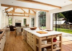 oh, to have a kitchen that opens right up to the outdoors (ps - check out those floors!)