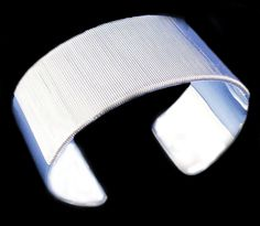 This is a nice 925 Sterling Silver Wide Cuff Bangle Bracelet, 3 cm wide and 7 cm in diameter. The bracelet weights 48 gram.