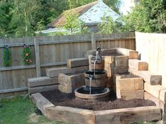 This might work for the goldfish pond. Just make the bottom container big and deep. But where in the yard to put it? Against white fence instead of in… - Alles über den Garten Backyard Water Feature, Ponds Backyard, Backyard Landscaping, Corner Landscaping Ideas, Railroad Ties Landscaping, Diy Garden Fountains, Diy Fountain, Water Fountains, Barrel Fountain