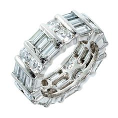 Kwiat Round and Baguette Diamond Platinum Wedding Band | From a unique collection of vintage band rings at https://www.1stdibs.com/jewelry/rings/band-rings/