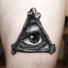 Black eye / bone / triangle tattoo / ink