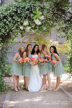 Minty seafoam green bridesmaid dresses with pretty colorful bouquets  Allison Stahl Photography