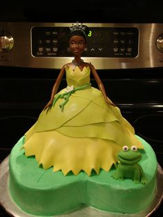 Princess and the Frog Cake - Princess and the Frog cake for a little girl turning 4 at the shelter. Chocolate cake, BC frosting, fondant decoration. Purchased a Tiana Barbie doll to use in the cake, so she would have a toy to play with when the cake was gone. The cake was a hit at the shelter and the little girl just loved it. Thanks for looking!