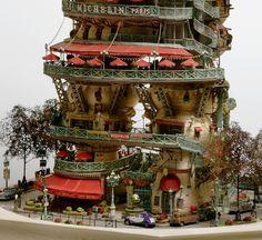 Takanori Aiba começou sua carreira como ilustrador e agora passa o seu tempo esculpindo cidades em miniatura em nada menos do que árvores de bonsai. Apesar das obras não terem mais do que 50 centímetros de altura, ele cria verdadeiras cidades, ilh...