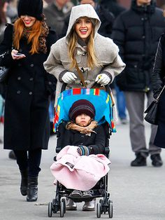 Heyyyy...isn't the baby supposed to look cuter than the mom? Lolz. That's Jessica Alba, by the way.