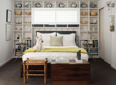 Great idea for back bedroom.  Reorienting bed plus the shelving would really open up the space.