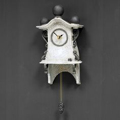 quirky ceramic pendulum wall clock - small - white by ian roberts - This marvellous little white ceramic wall clock with pendulum has been handmade by Ian Roberts. The clock is hand painted and raku fired giving it a unique finish, in this instance a cracked glaz