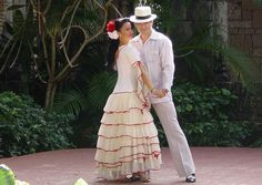 It's that same dress.   That's apparently the traditional Cuban dancer dress.   And it seems to be specific to Cuba.