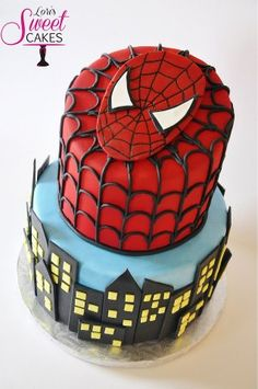 This Spiderman cake has dark chocolate inside and touches of dark chocolate outside as web and urban setting