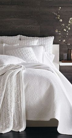 White... Bedding very neutral clean look always add a touch of colour very versatile.