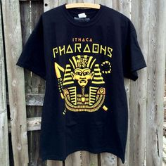 Alpha Phi Alpha inspired t-shirt.    Inspired by sports teams logos. We wanted to create our own version of a powerful representation of Alpha if it were your favorite minor league baseball or sports team!    Inspired by Egyptology we designed this awesome Ithaca Pharaohs character.   #ALPHAPHIALPHA #APHIA #EGYPT #PHARAOH #BLACKANDGOLD