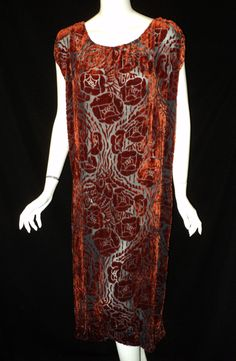 1920s Voided Velvet Crepe Dress Silk chiffon, voided velvet  Rust colored velvet floral pattern on a blueish gray crepe background. The dress has a drop waist with cap sleeves and a ruched back. This dress would be worn with an underslip.  Private Collection Front 1