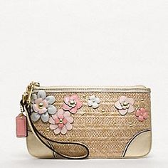 A cute floral and straw clutch in the Hamptons Weekend collection... by Coach. X: So... Because I just can't justify ever spending this amount of money on a tiny little clutch, I will never own this--but that doesn't mean it's not cute.<3