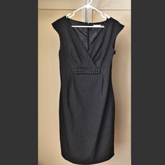Charcoal Calvin Klein fit + flare Charcoal Calvin Klein fit + flare sleeveless dress gathers at the natural waist and ends slightly (~2 in) above the knee.  V neck with classic fabric embellishment below the bust. Fully lined, with darts for flattering fit. Excellent condition, worn only twice. Calvin Klein Dresses Midi