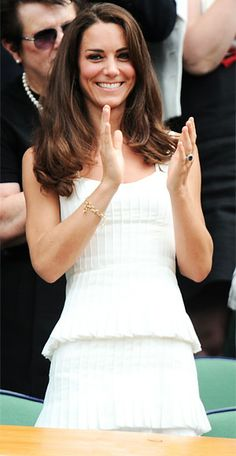 Taking in the action at Wimbledon, Kate wears a Temperley dress in the tournament's traditional white.