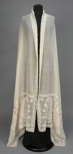 WHITEWORK EMBROIDERED COTTON SHAWL, EARLY 19th C. Long muslin rectangle, probably Bengali, having a serpentine border of vining strawberries in broderie Anglaise, and deep end borders with large elaborate botehs. 35 x 110. ID 133-37 - whitakerauction