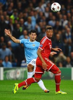 Sergio Agüero plays the ball past Jerome Boateng during the UEFA Champions League group D match between Manchester City and FC Bayern München at Etihad Stadium on October 2, 2013 in Manchester, England.