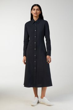 The A-line silhouette, slightly fitted around waist, gives a flattering fit to this shirt dress. The stretchy cotton cr pe fabric makes it perfect for comf