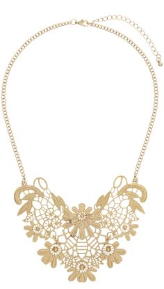 lace necklace - http://www.boomerinas.com/2015/03/13/lace-is-still-hot-modern-ways-to-wear-lace-for-spring-summer-2015/