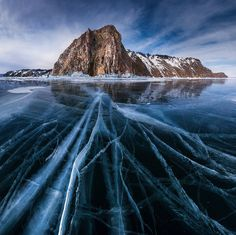 photos by satorifoto of russia's lake baikal. at 25 millions years old, it is the oldest freshwater lake on the planet. it's also the most voluminous, holding one fifth of the world's freshwater, as well as the clearest. from january to may, the lake completely freezes over, allowing trucks to drive across it.
