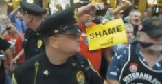 Watch Wisconsin Police Illegally Arrest A Veteran And Desecrate Our Flag ... For Singing (VIDEO)