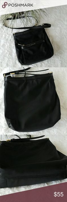 Michael Kors Crossbody Beautiful gently used Michael Kors crossbody. Black with gold hardware. 100% authentic. One zip pocket outside in front, and one inside. Two slip pockets inside. Nylon. Zip closure. No stains or damages. Approximate measurements provided. Photos are taken to the best of my abilities so please ask questions prior to purchase. Michael Kors Bags Crossbody Bags