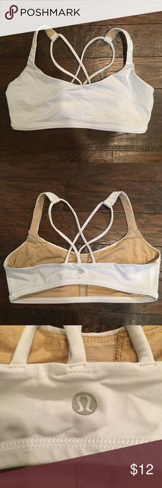 Lululemon Sports Bra 8 Lululemon sports bra. Does not come with pads. It says size 8. Has wear and no longer bright white. Still really cute. lululemon athletica Intimates & Sleepwear Bras