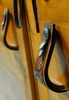Stirrups for door handles in western decorating. A fun rustic decor DIY project.   Stylish Western Home Decorating