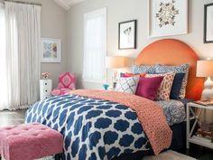 Blue ikat duvet cover, orange headboard, moroccan pattern bedroom, home goods, white lamps, art above nightstands, wonderful