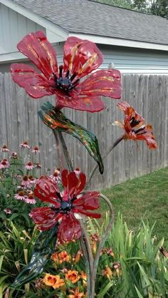 "this is so pretty....i wouldn't want them outside when it's windy.....""Poppies In The Flower Garden"" Delphi Stained Glass"