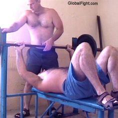 benchpressing home garage workout