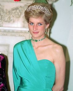 July 14, 1988, Princess Diana attends a Banquet at Claridges hosted by the President of Turkey, Kenan Evren.
