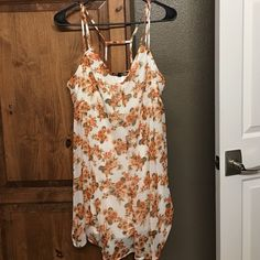 Floral longer length top Bought from Tillys. Never worn or washed. Tighter fit around the bust area so it was uncomfortable for me. Size L. 100% polyester. Happening in the Present Tops Tank Tops
