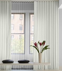ripple fold drapery - may sit flatter together and fit in space between window and wall better than pinch-pleat...