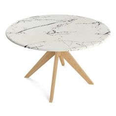 Stephen Dining Table - Boasting a sophisticated faux white marble top, the Stephen Dining Table promises to infuse elegant modern style into your dining space.