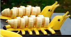 Learn how to make an yellow dolphins garnish with a bananas. Funs for kids and adults alike. It is also no secret that why we all love Bananas. L'art Du Fruit, Deco Fruit, Fruit Art, Fruit Cakes, Fruit Salad, Bananas, Cucumber Flower, Banana Art, Fruit And Vegetable Carving