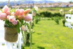 soft pink tulips in mason jars wrapped in burlap on shepherd hooks/ blooming floral studio